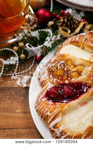 Christmas Background Baking Dessert. Danish Pastry Ring with Cherry, Apple fruit and Cheese fillings. Selective focus.