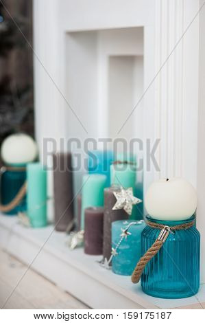 Turquoise, Mint, Brown Candles In Fireplace Portal. Horizontal