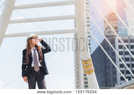 Middle-aged Engineer Or Architect Woman Wearing Construction Hard Hat Or Helmet Looking Up. Middle-a