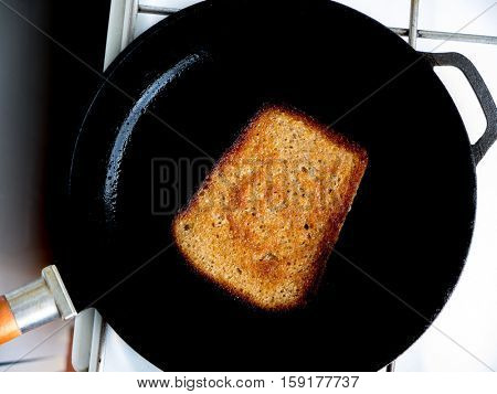 The fried bread in a pan.