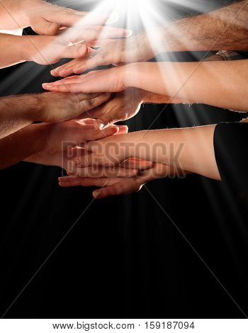 hands clasped in black background