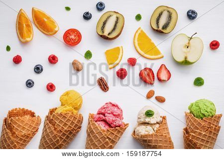 Cones And Colorful Various Fruits Raspberry ,blueberry ,strawberry ,orange Slice , Halve Kiwi ,apple