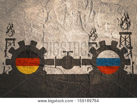Image relative to gas transit from Russia to Germany . Gears connected by gas pipe. National flags on cog wheels. Concrete textured