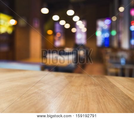 Table top Colourful light Blurred Bar Seats Restaurant Cafe interior background