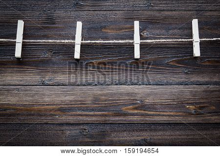 Wood Cloth Peg And Hemp Rope On Brown Plank Background