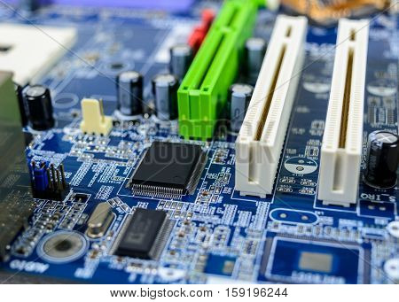 Computer motherboard with electronic component detail background.
