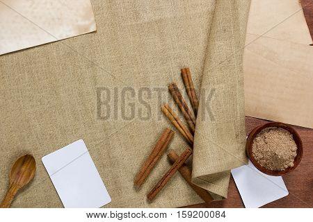 Cinnamon sticks and meal on a linen napkin