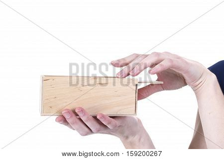 Hands of woman open wooden box on a white background