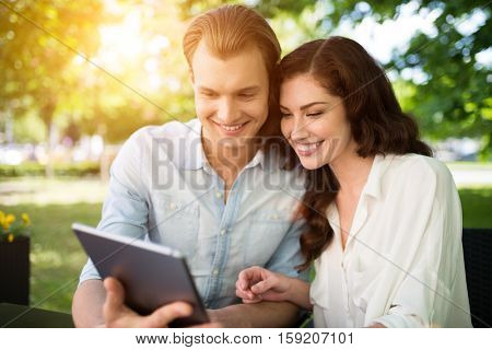 Young couple using a digital tablet together outdoor