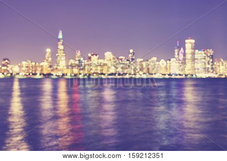 Vintage Toned Blurred Chicago City Lights With Reflection In Lake Michigan At Night.
