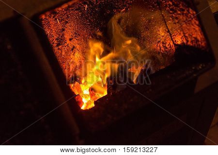 Fire In Fireplace. Close Up Of Red Fire In Stove