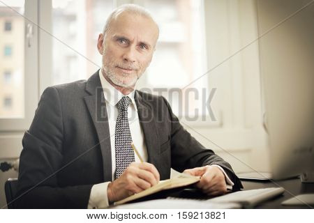 Guy making notes