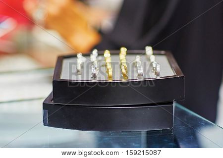 Jeweler Stand With Selection Of Wedding Rings