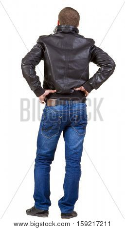 Back view of handsome man in jacket.  Standing young guy in jeans and  jacket. Rear view people collection.  backside view of person.  Isolated over white background.