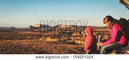 mother and little daughter travel by car in mountains, family travel