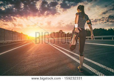 stretching run runner road jogging clothes flare sunset street fitness cross sunbeam success running sportswear - stock image