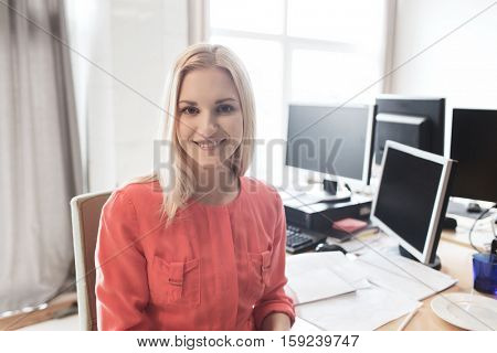business, startup and people concept - happy businesswoman or creative female office worker with computers