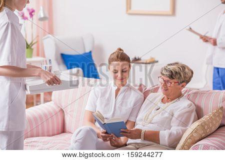 Nurse, Caregiver And Senior Patient