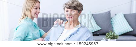 Aged Woman And Assistant