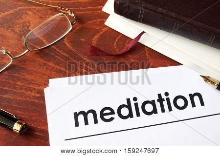 Papers with title mediation on a table.