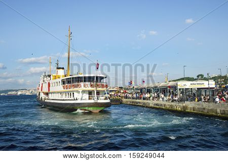 Istanbul Turkey - July 26 2016: Istanbul Ferries Eminonu waiting in the harbor. (called vapur in Turkish) continue to serve as a key public transport link for many Thousands of commuters tourists and vehicles per day.