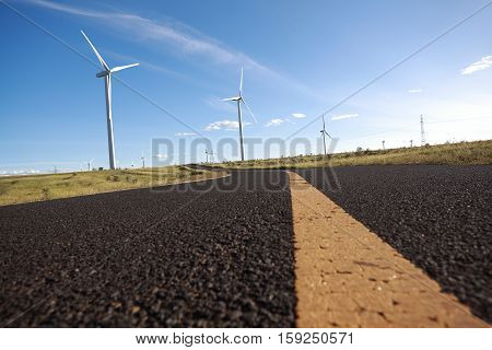 Environmentally friendly power generation wind power turbines on the side of dual carriageway road at panoramic