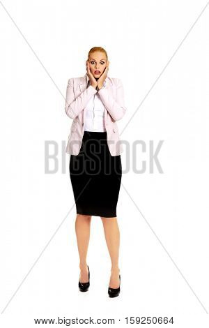 Shocked business woman holding hands on chin