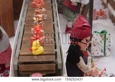 BRNO,CZECH REPUBLIC-NOVEMBER 19,2016:Miniature toys on conveyor belt at shopping center Olympia on November 19, 2016 Brno Czech Republic