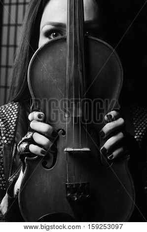 beautiful girl touch violin in the hands