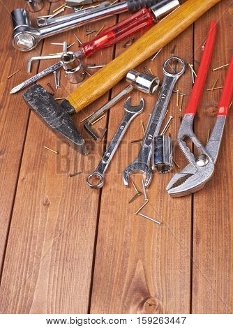 Set of different work tools on wooden brown surface