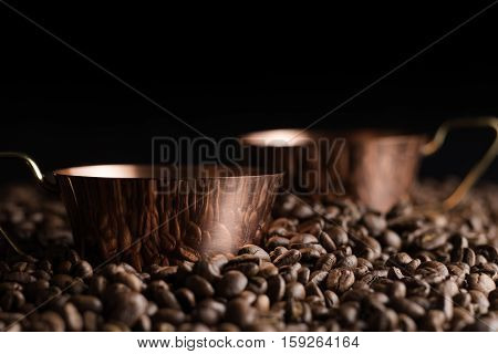Two Bronze Cup Full Of Coffee On The Grains Pile. Italian Traditional Morning Short Drink On Breakfa