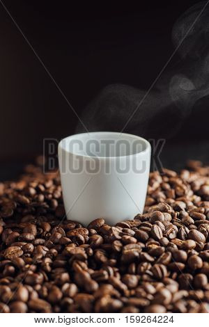 Espresso Cup Full Of Coffee On The Grains Pile. Italian Traditional Morning Short Drink On Breakfast