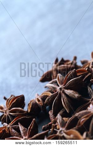 Star Anise Seeds On The Blue Blurred Background
