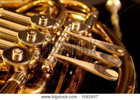 Close Up Of A French Horn On A Black Background