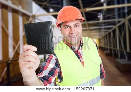 Smiling Construction Worker With Money Wallet
