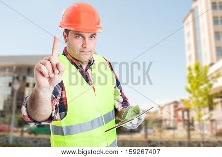 Busy Constructor Holding Modern Tablet Outdoors