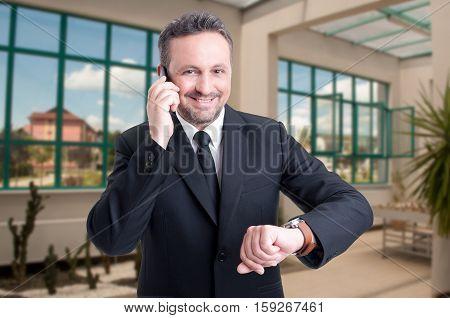 Handsome Estate Broker Man Talking On Cellphone