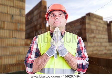 Male Builder Praying For Something