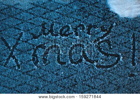 write merry x mas in the snow, the snow on iron background, inscription, happy holidays