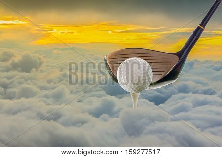 golf club and ball on clouds at sunset. concept idea