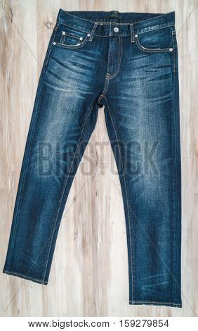Blue jeans on  wooden background
