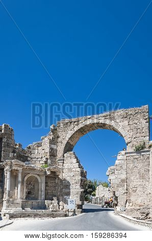 Entrance gate to the city amongst the ruins of Ancient Side Antalaya Turkey.