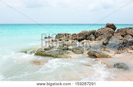 Rocks in the caribbean sea on Aruba island