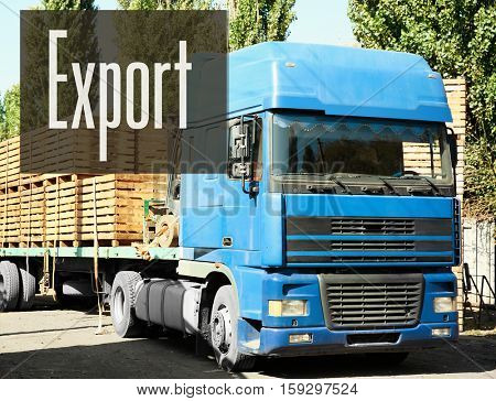 Truck loaded with wooden crates. Word EXPORT on background. Wholesale and logistics concept.