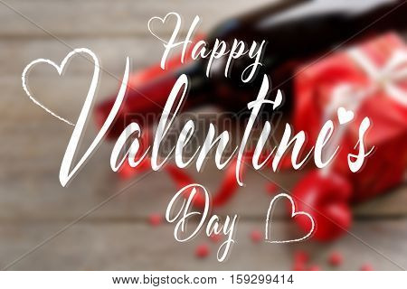 Text HAPPY VALENTINE'S DAY on blurred background
