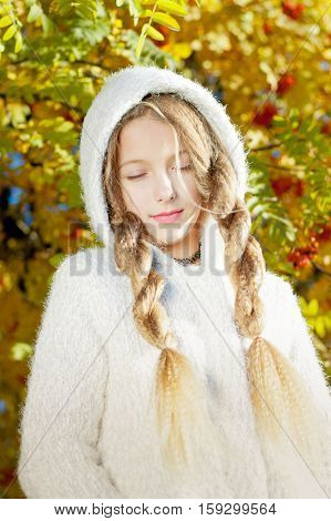 girl with flowing hair on the background of a tree with rowan