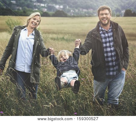 Family Parents Holding Hands Boy Swinging Concept
