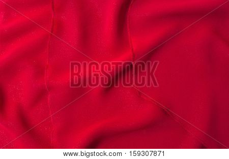 Red fabric texture background. Horizontal color photo