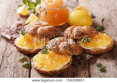 Sweet Sandwiches With Lemon Marmalade, Mint And Butter Close-up. Horizontal