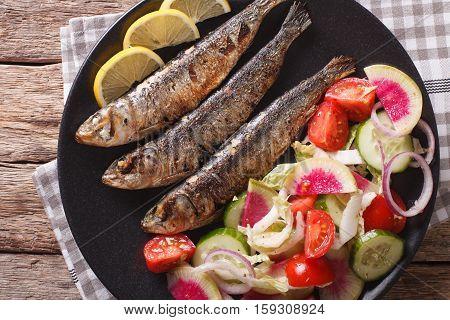 Mediterranean Food: Grilled Sardines With Fresh Vegetable Salad Close-up. Horizontal Top View